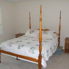 Antique four post canopy bed, bedside tables