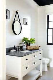 white wall bathroom cabinet modern farmhouse bathroom with walls white vanity black counter and natural fiber