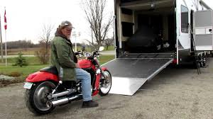 load and unload motorcycle toy hauler using clutch instead of brake