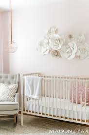 paper flowers as wall decor in a nursery what a gorgeous soft feminine