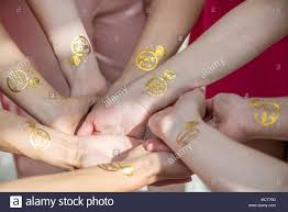 Macro Shot Of Temporary Tattoo Of A Ring On Bridesmaids Hands Held