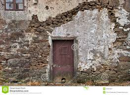 old stone wall with door