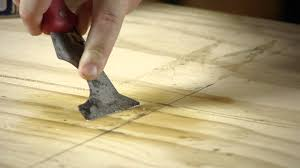 how to remove a l and stick tile adhesive from plywood working on flooring you