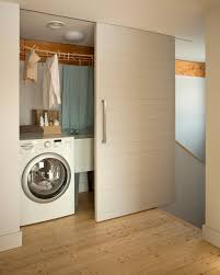 california closets sliding doors laundry room contemporary with wood trim small room wood trim