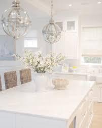 White kitchen. Carrara marble. Bamboo roman shades. Rattan bar ...