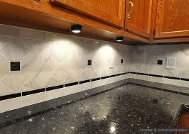 black countertop white marble backsplash