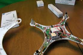 drone spotting 2015 in each arm is the esc electronic speed control for each motor they are the long skinny circuit board it also holds the arm leds