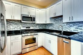 simple white cabinets dark counters kitchen ideas off backsplash for new black countertops what color walls