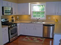 incredible white wooden painted kitchen cabinets with yellow wall ideas and wooden floors as l shape small kitchen design ideas