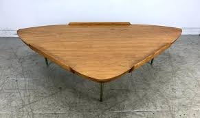 modernist guitar pick shape table inspired coffee herman miller