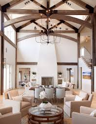 High-ceilinged great room with dark wood exposed beams and neutral  furnishings | Tracy Hardenburg