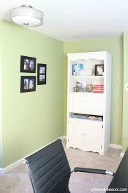 green home office. love this home office makeover she organized the craft closet hemmed curtains and painted green
