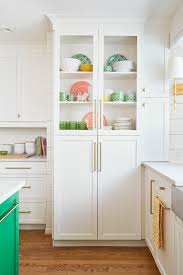 antique white shaker cabinets. white floor-to-ceiling shaker cabinets with open view antique