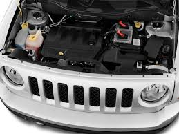 rusty strut tower, shock bolt/nut, water collecting - Jeep Patriot ...