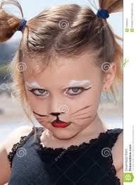 child with kitty cat make up
