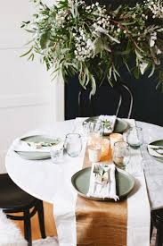 A warm scandinavian modern holiday tablescape to inspire you to entertain  even in a small space
