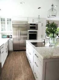 dallas white granite countertops with dark cabinets