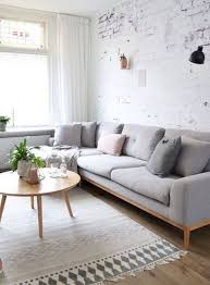 living room vaulted style of white ceiling black and white sofa navy blue and white combination