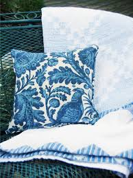 pillow and throw on teal bench