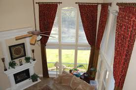 interior red pattern curtains having tie back and bronze curtains rod plus white windows blind