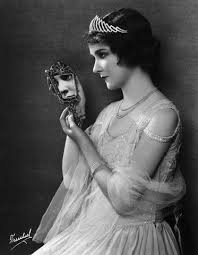 woman holding hand mirror. portrait of actress mary philbin holding a hand mirror which once belonged to the late czarina russia. woman l