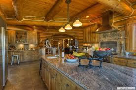 5 log home dining room carved arch 6 log home custom kitchen 7 log home gourmet kitchen 8 log home granite counter island 9 log granite gourmet kitchen