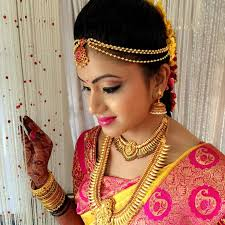 south indian bride pink kanchipuram silk sari temple jewelry braid with fresh flowers