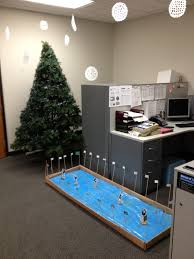 Christmas decorating themes office North Pole Mesmerizing Simple Christmas Trees Decor With Grey Office Tables And Hanging Accesories For Cool Christmas Office Decoration Designs Detectview Mesmerizing Simple Christmas Trees Decor With Grey Office Tables And