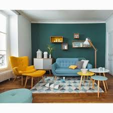 living room wooden floor blue sofa yellow lounge chair with ottoman blue