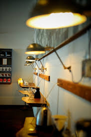 custom made teel and brass wall lamp with parabolic steel shade