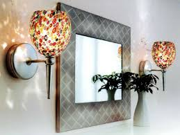 glamorous cordless wall sconce wireless remote control sconces mirror and white wall and vase with plant