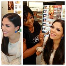 l oreal paris pro makeup artist using l oreal paris true match powder on candra for a flawless finish