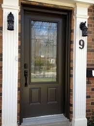 Beauteous Dark Brown Color Wooden Front Door With Glass Also Bronze Color  Metal Handles And Orange