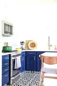 blue and white kitchen navy blue kitchen cabinets black and white tile floor and gold cabinet hardware blue white kitchen tiles