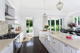 beautiful white kitchen cabinets: kitchen with white shaker style cabinets white quartz counter and dark hardwood floors