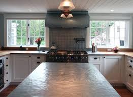 concrete subway tile backsplash kitchen grey dark white cooking cabinet laminated floor window concrete countertop with