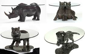 Bronze Collection Of Animals Tables Emerging Out Of Glass Surfaces -  Freshome.com