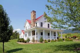 farm style house plans covered front porch red metal roof standing seam metal roof white clapboard