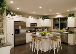 modern white kitchens with dark wood floors. Fine Modern In This Cozy Ushaped Kitchen A Granite Topped Island Stands Surrounded By  Pristine Throughout Modern White Kitchens With Dark Wood Floors D