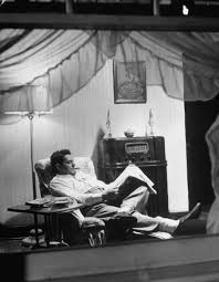 best photographer alfred eisenstaedt images  fire chief bob harmon sitting at home at night reading the newspaper while listening to the radio from essay an american block re small town block in