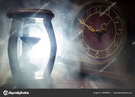 Lighting Time Clock Time Concept Silhouette Of Hourglass Clock And Old Vintage