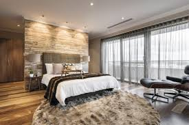 attractive bedroom design with extra large round area rugs and stunning headboard ideas