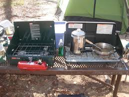 white gas coleman on the left propane canister on the right