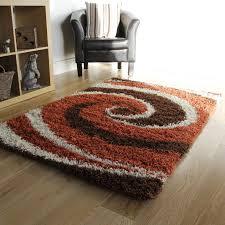 orange and brown swirl gy rug