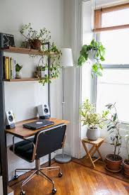 small desk home office. Modern Home Office And Small Floating Wood Desk With Near Bright Glass Window Surrounding Hanging Plants Wall Mounted Shelves Corner Floor Lamp L