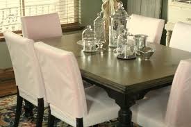 gorgeous white slip cover for dining room chairs in simple style with evening hue dining table