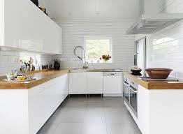 white subway tiles, butcher block countertop, side-by-side ovens