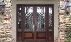 appealing beveled glass entry doors with mahogany material and trellis glass door featuring natural stone wall and wall sconces