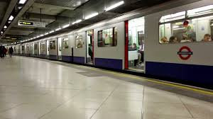 subway train side.  Side London Underground Subway Side Perspective View Of Train Doors Closing And  Pulls Out The Station With Reflections On Platform Floor  For Subway Train I