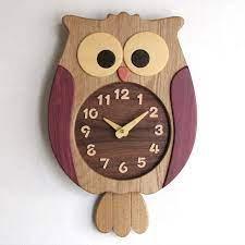use designer wall clocks to enhance